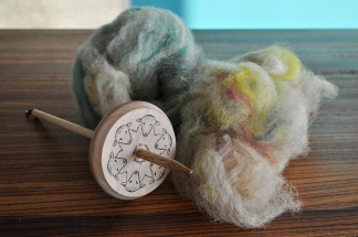 spinning wool with a drop spindle